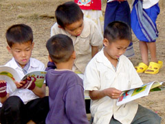 Boys reading outdoors