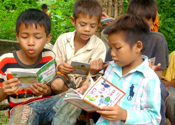 Kids enjoy their books, after listening to stories from teachers